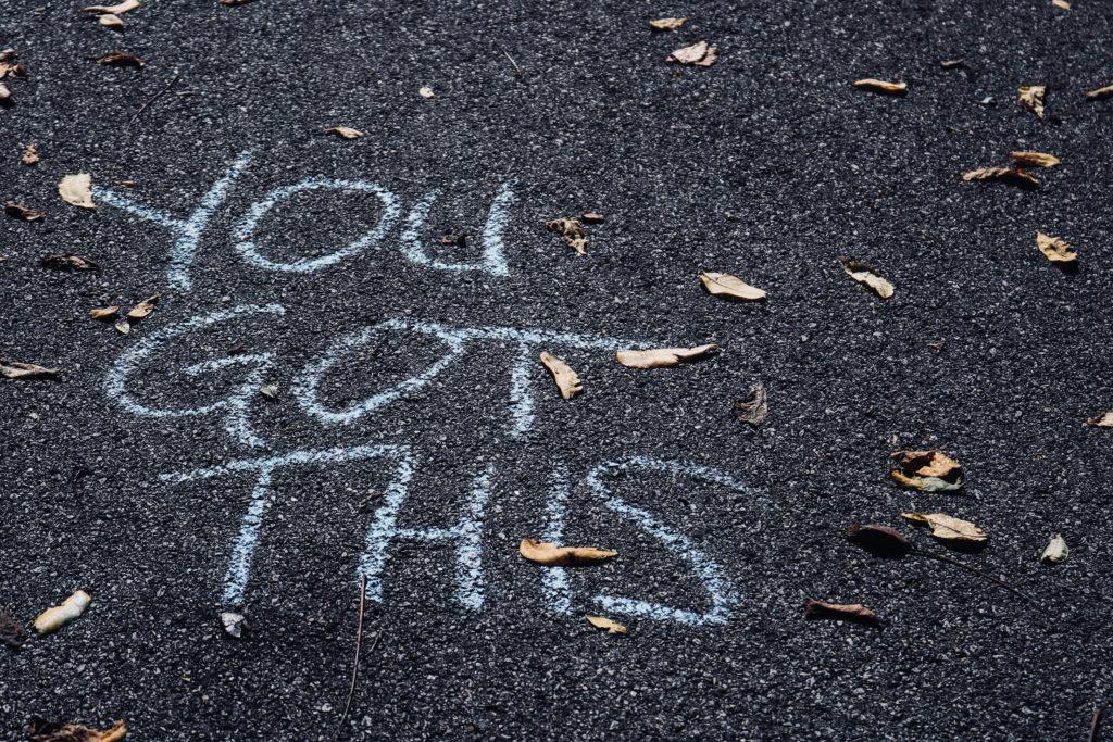 You Got This written in chalk on asphalt.